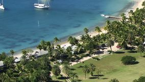 Antigua Caribbean perfect vacation on palm tree beach. Antigua Caribbean with yachts and boats in harbor stock video footage