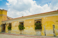 Antigua city in guatemala. Yellow wall colonial architecture in antigua city in guatemala Royalty Free Stock Photography