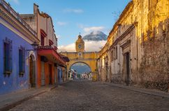 Antigua City at Sunrise, Guatemala. The colorful colonial style main street of Antigua City at sunrise with the famous yellow Santa Catalina arch in the city stock photos
