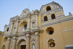 Antigua Colorful Old Town In Guatemala. The beautiful old city of Antigua Guatemala, with colorful buildings and monuments and its picturesque paved street with royalty free stock images