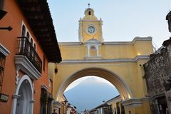 Antigua Colorful Old Town In Guatemala. The beautiful old city of Antigua Guatemala, with colorful buildings and monuments and its picturesque paved street with stock photos