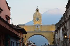 Antigua Colorful Old Town In Guatemala. The beautiful old city of Antigua Guatemala, with colorful buildings and monuments and its picturesque paved street with stock photography