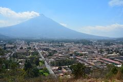 Antigua Colorful Old Town In Guatemala. The beautiful old city of Antigua Guatemala, with colorful buildings and monuments and its picturesque paved street with royalty free stock photos