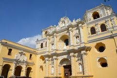 Antigua Colorful Old Town In Guatemala. The beautiful old city of Antigua Guatemala, with colorful buildings and monuments and its picturesque paved street with royalty free stock image