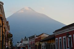 Antigua Colorful Old Town In Guatemala. The beautiful old city of Antigua Guatemala, with colorful buildings and monuments and its picturesque paved street with stock images