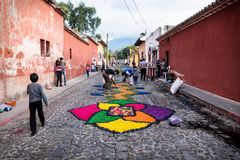 Peoople making alfombre flower carpets on the cobbled streets of Antigua, Guatemala stock photo