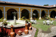 Antigua - Guatemala. An house with a garden and fountain in the city of Antigua Guatemala stock images