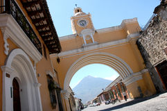 Antigua - Guatemala. An arch with a clock in the city of Antigua Guatemala Stock Image