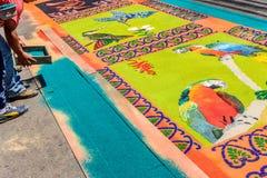 Making dyed sawdust Holy Thursday carpet, Antigua, Guatemala stock photography