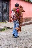 Selling crucifixes during Holy Thursday celebrations, Antigua, Guatemala. Antigua, Guatemala -  April 13, 2017: Selling crucifixes on Holy Thursday in town with Stock Photography