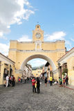 ANTIGUA, GUATEMALA - AUG 16, 2014: Arch of Santa Catalina, the city icon Stock Photos