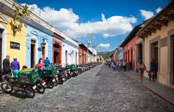 Main street with local people and colonial houses in Antigua. Gu stock image