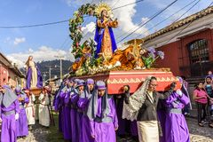 Lent procession in street of Antigua, Guatemala. Antigua, Guatemala -  February 18, 2018: Lent procession in colonial town & UNESCO World Heritage Site with most royalty free stock photography