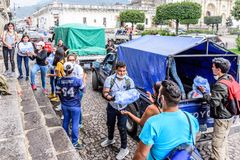 Humanitarian aid after Fuego volcano eruption, Antigua, Guatemala. Antigua,, Guatemala - June 5, 2018: Volunteers load humanitarian aid supplies outside town stock image