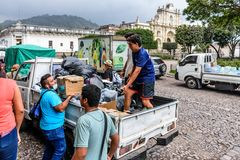 Humanitarian aid after Fuego volcano eruption, Antigua, Guatemala. Antigua,, Guatemala - June 5, 2018: Volunteers load humanitarian aid supplies outside town royalty free stock images