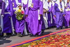 Good Friday procession beside dyed sawdust carpet, Antigua, Guatemala royalty free stock images