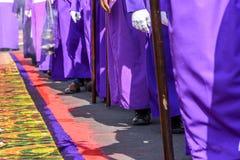 Closeup of Good Friday procession beside dyed sawdust carpet, Antigua, Guatemala royalty free stock photos