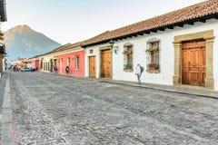 Colonial street & Agua volcano, Antigua, Guatemala royalty free stock images