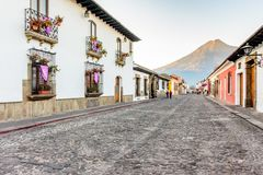 Colonial street & Agua volcano, Antigua, Guatemala royalty free stock photos