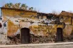 ANTIGUA, GUATEMALA: Rundown old building. ANTIGUA, GUATEMALA - APRIL 5, 2009: Rundown old building in UNESCO World Heritage Site of Antigua. Writing on wall Stock Image