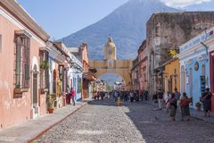 Antigua, Guatemala Santa Catalina Arch. Antigua, Guatemala - March 4, 2017: Cobblestone street with Colorful landmark Santa Catalina Arch dating to the 1600s & Stock Images