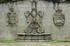 Antigua Guatemala Wall Fountain. Along with some sort of governmental shield royalty free stock photo