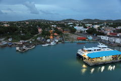 Antigua Island, Caribbean. Twilight view at St. John Antigua Island. Bryson's Pier ( Blue roof) , the ferries to go to Montserrat and others Island Stock Photo
