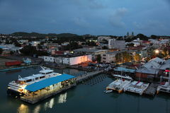 Antigua Island, Caribbean. Twilight view at St. John Antigua Island. Bryson's Pier ( Blue roof) , the ferries to go to Montserrat and others Island Royalty Free Stock Photography