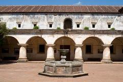 Antigua - monastery yard. Patio with arcade and fountain, convento de las capuchinas, antigua, guatemala Stock Images