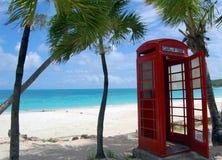 Antigua phone box. Red phone box on beach in antigua stock photography