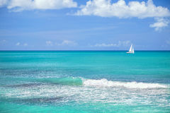 Antigua Sailboat. A sailboat on the horizon from the shores of the Caribbean island of Antigua Royalty Free Stock Images