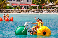 Antigua - Sandals Dickenson Bay Waterbike Fun! Stock Image