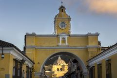 Spanish Colonial Architecture in Old City Antigua Guatemala with Santa Catalina Arch and Catholic Church Iglesia de la Merced in t stock photography