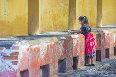 Antigua street laundry. ANTIGUA , GUATEMALA - JULY 30 : Guatemalan girl wash laundry in a traditional street washing facility in Antigua, Guatemala on July 30 stock images
