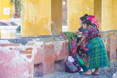 Antigua street laundry. ANTIGUA , GUATEMALA - JULY 30 : Guatemalan women wash laundry in a traditional street washing facility in Antigua, Guatemala on July 30 royalty free stock photo