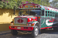 Antigua to San Pedro. Chicken bus driving throught the old cobbled streets of Antigua. Old American School buses are given a new lease of life in Guatemala as stock image