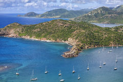Antigua. A view from Shirley Heights of English Harbour and Fort Berkeley on the coast of the island of Antigua in the Caribbean Stock Photos