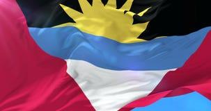 Antigua y Barbuda señalan agitar por medio de una bandera en el viento en lento con el cielo azul, lazo