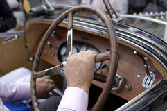 Antigue car. Detail of the steering wheel and dashboard of an antique car Stock Images