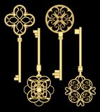 Antigue door key set in golden metallic design with historic ornamental vintage patterns. Stock Image