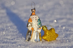 Antigue santa claus toy for Christmas tree on snow Royalty Free Stock Photo