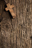 Antigue wooden cross on old wooden background stock photos