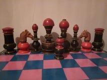 Antiguidade colorida de madeira do grupo de xadrez Fotografia de Stock Royalty Free