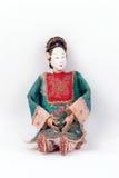 antik asiatisk docka Arkivfoto