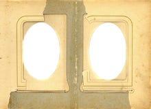 Antik bakgrund för papper för sida för fotoalbum med det två isolerade hålet arkivfoto