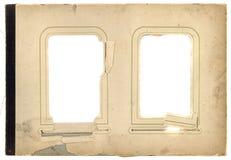 Antik bakgrund för sida för fotoalbum tattared med det två isolerade hålet fotografering för bildbyråer