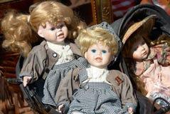 Antik dolls. Several old dolls at a flea market Royalty Free Stock Photography