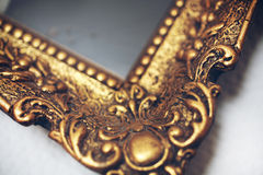 Antik gold picture frame. Detail of an antik gold picture frame Stock Photos