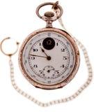 Antik guld- klocka en kedja Royaltyfria Foton