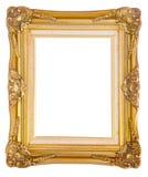 Antik guld- ram som isoleras på vit bakgrund Arkivbild